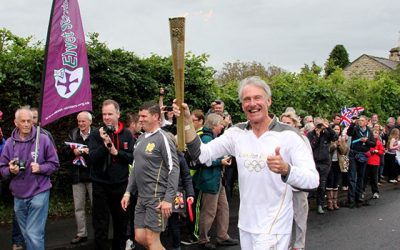 The Olympic flame passes through